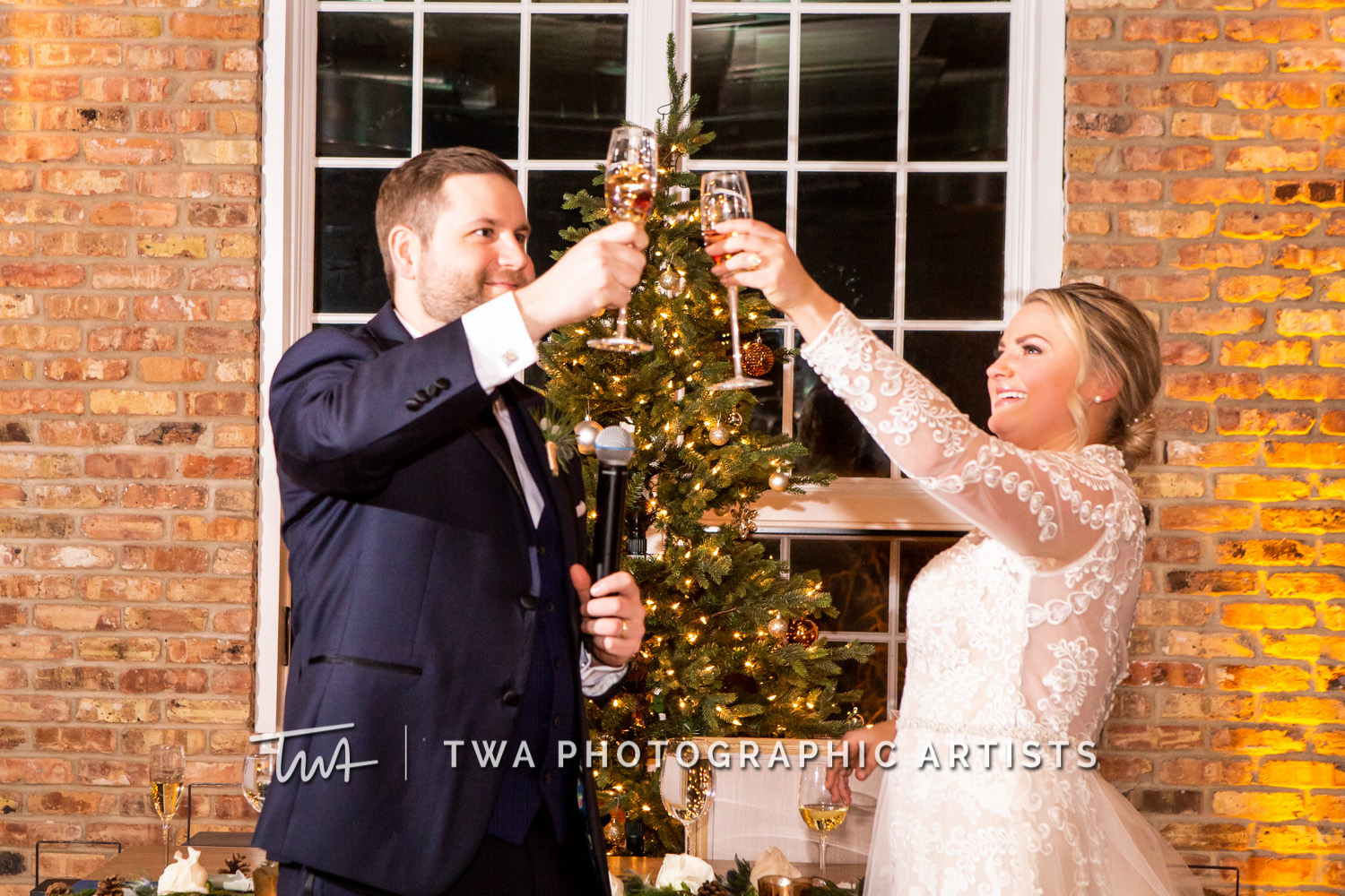 Bride and groom cheering at winter wedding