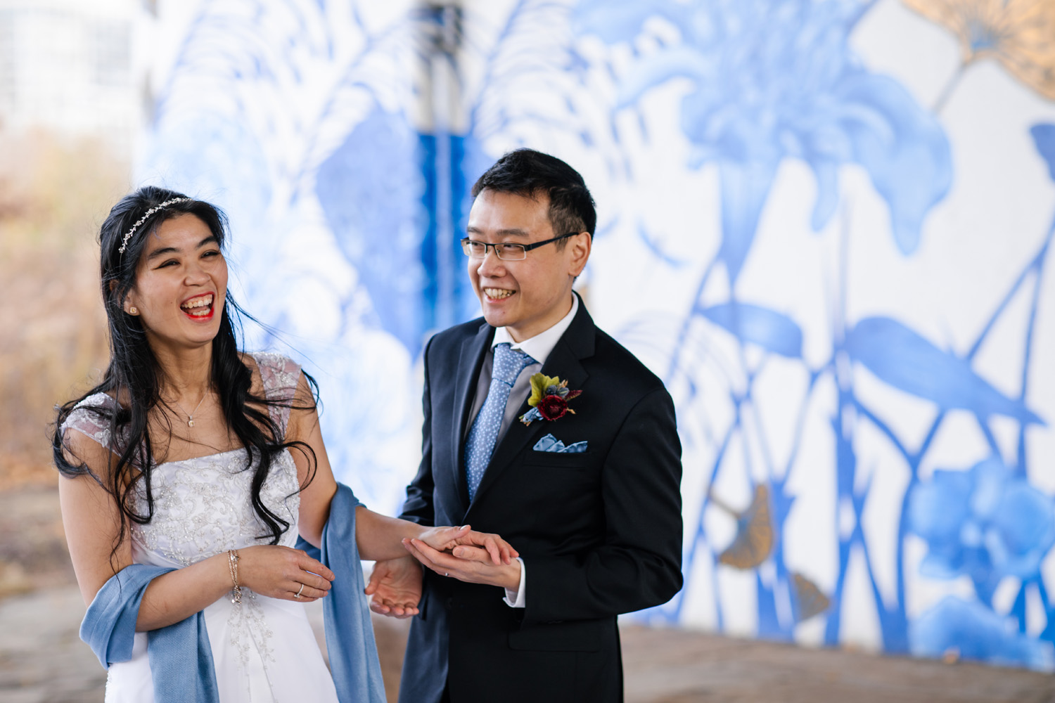 bride and groom laughing in outdoor wedding ceremony