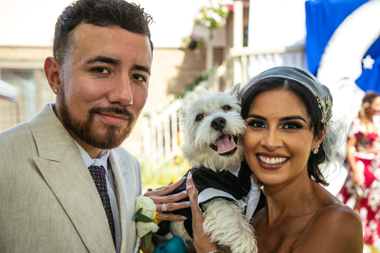 Bride and Groom posing with dog ring bearer