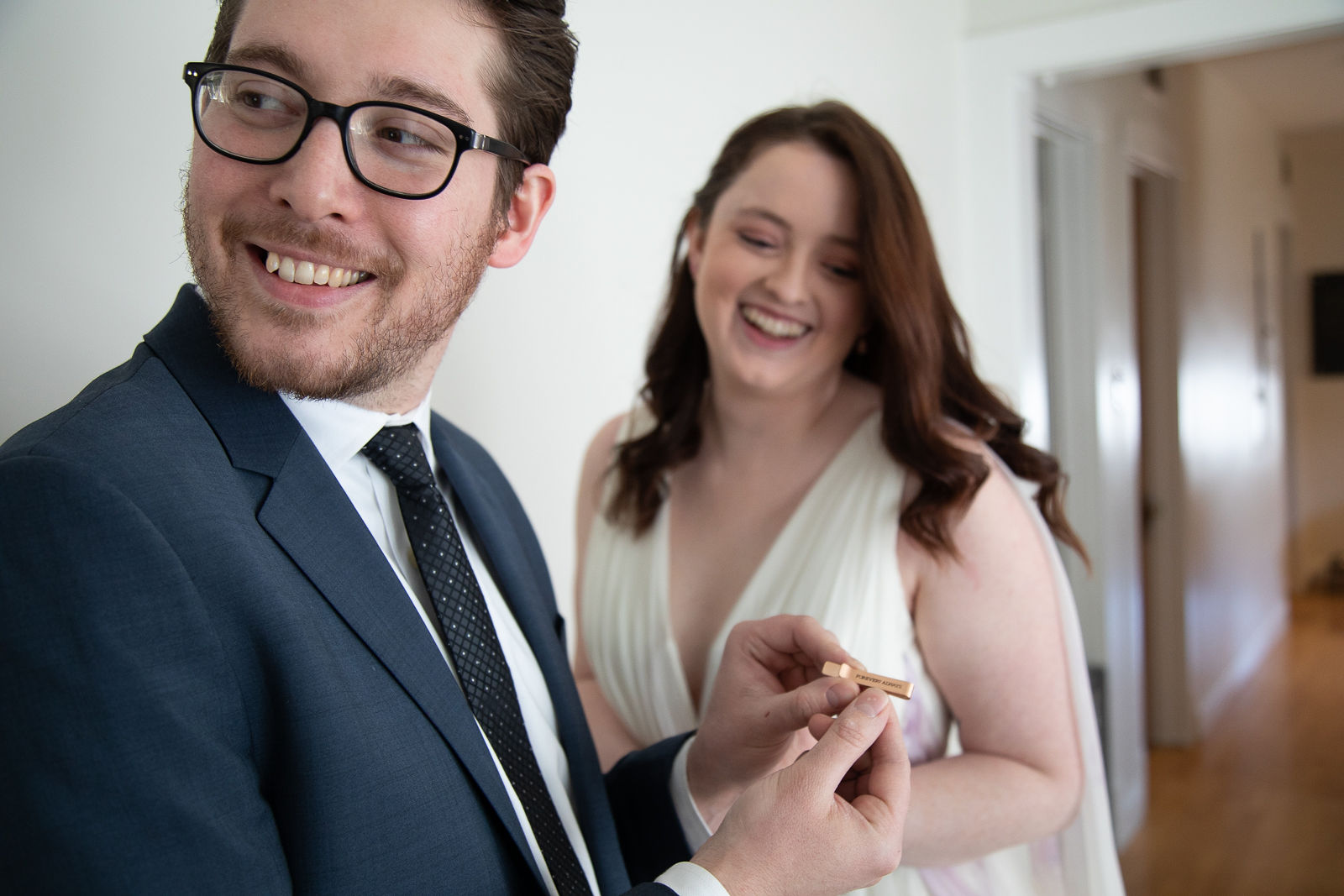 intimate wedding first look groom accessories tie bar