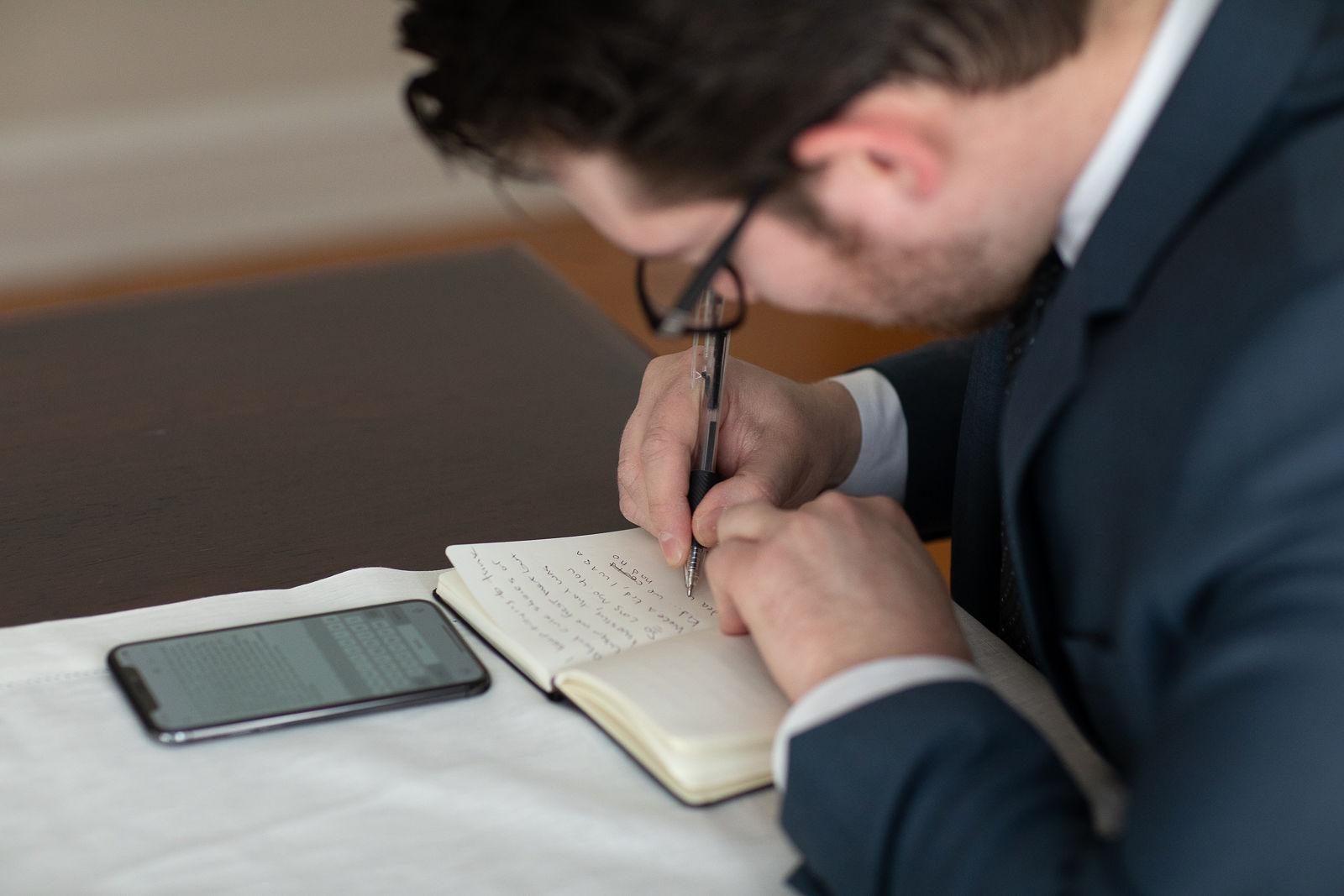 intimate wedding groom writing vows